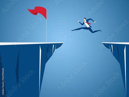Cuadros en Lienzo  Businessman jump through the gap obstacles between hill to red flag and success
