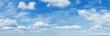 Leinwandbild Motiv Sunny blue sky backgrond with clouds Panorama Photo