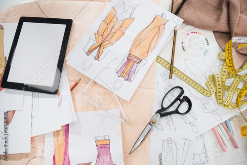 close up view of various design supplies, clothing sketches