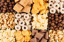 Corn Flakes Collection On Different Cereals, Decorative Background. Top View.