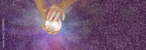 Fortune Teller holding crystal ball on sparkling banner - Female fortune teller holding a large  crystal ball in cupped hands against a sparkling magenta  background with copy space
