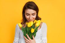 Lovely Woman Enjoying Flowers