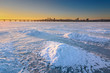 Beautiful winter landscape with frozen river and sunset sky II