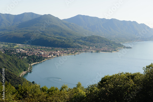 Fotografie, Obraz  View from above on Luino and Lago Maggiore with the mountain peaks in the backgr