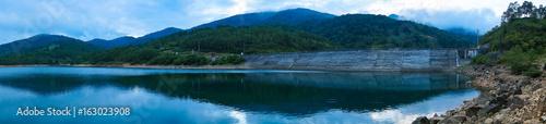 Dam and lake i n the mountain at dusk