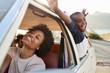 Leinwandbild Motiv Mother And Children Relaxing In Car During Road Trip