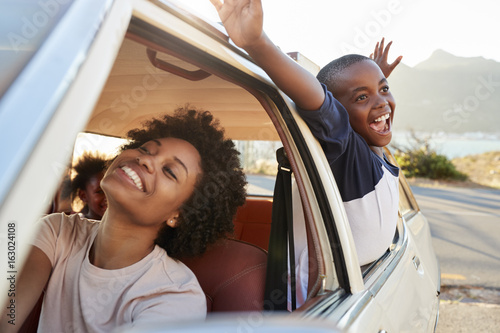 Fototapeta Mother And Children Relaxing In Car During Road Trip