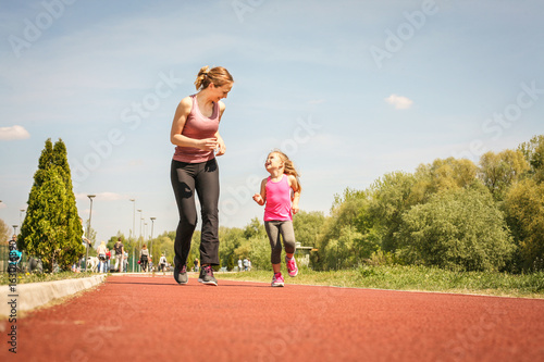 Foto op Canvas Jogging Caucasian mother and daughter jogging outdoors.