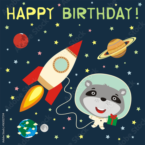 Photo  Happy birthday! Funny raccoon with gift in spacesuit next to rocket in space