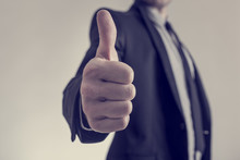 Toned Image Of Businessman Showing A Thumbs Up Sign Towards You