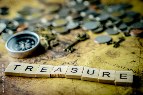 Vintage treasure hunting concept with coins and compass