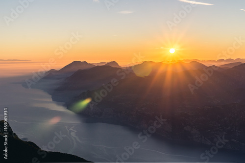 Photo Sunset over the Mountains with Lens Flare