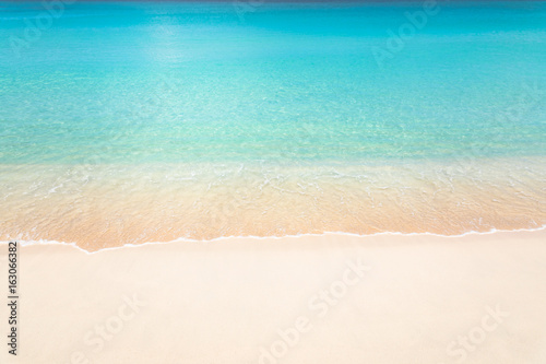 Calm tropical beach with turquoise water Wallpaper Mural
