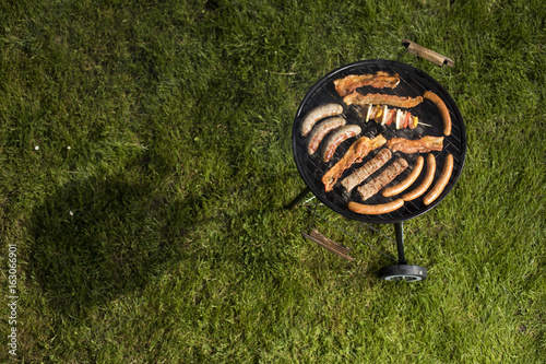 Grill with smoke over summer outdoor nature in garden Wallpaper Mural
