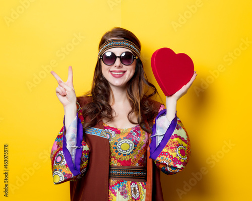 Young hippie girl with sunglasses Wallpaper Mural