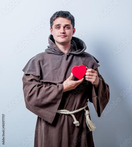 Valokuva  Portrait of Young catholic monk with heart shape