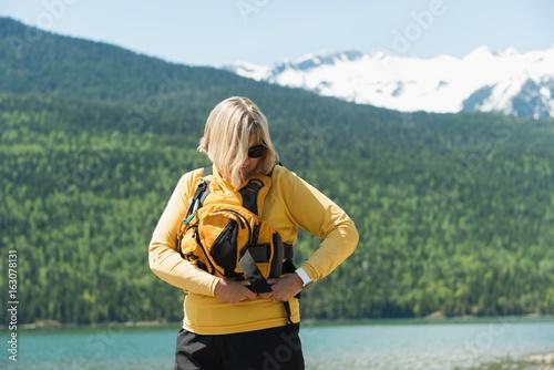 Mature woman wearing life jacket