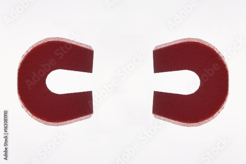 Photo  Two Red Magnets on White Background