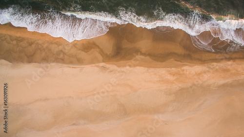Staande foto Oceanië Aerial view of ocean sea waves on sandy beach at evening