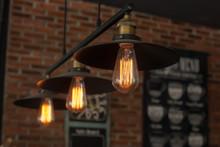 Vintage Interior Lighting Lamp In Coffee Shop.