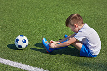 Boy Football Soccer Tying Laces Him Boots On Grass