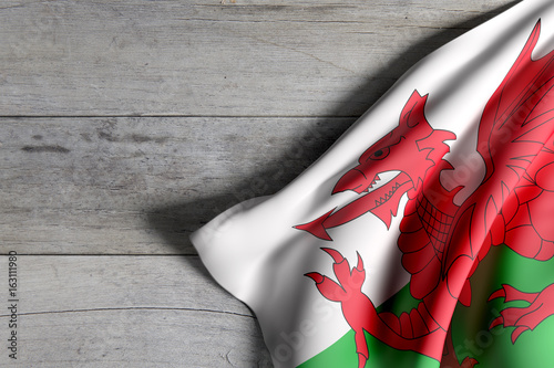 Canvas Print Wales flag on wooden surface