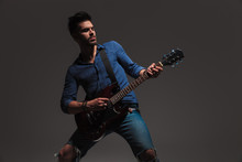 Young Man Playing His Electric Guitar