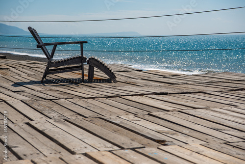 beautiful blue sea view and wooden relaxing chair