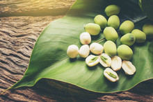Freshness Lotus Seed And Pod On Green Leaf Laying On Wood Background