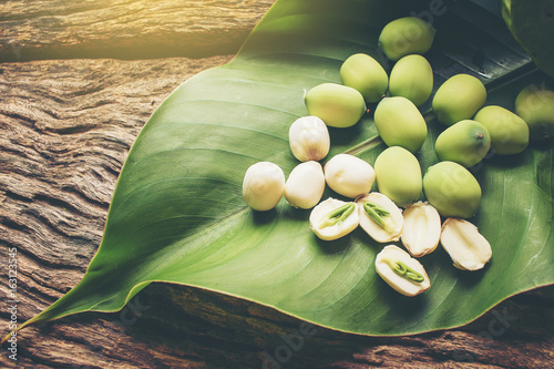 Photo Stands Water lilies Freshness Lotus seed and pod on green leaf laying on wood background