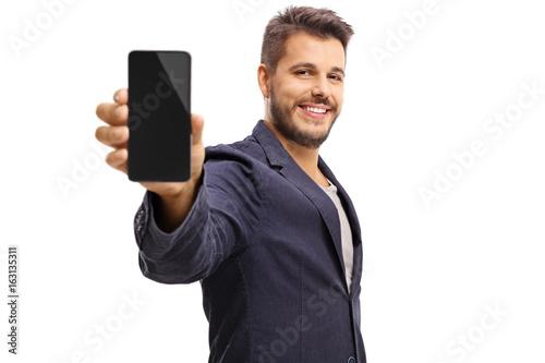 Fotografía  Young guy showing a phone