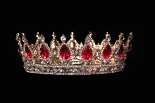 Red Crown With Red Gems Isolated On Black Background