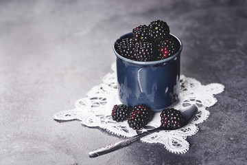 Fototapeta na wymiar Delicious blackberries in the retro cup