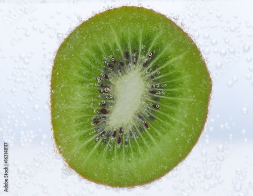 Recess Fitting Splashing water Slice of kiwi in water with air bubbles on it