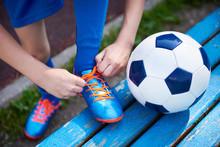 Boy Football Soccer Tying Lace...