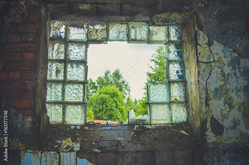 Photo  Abandoned interior in ruins of military settlement.