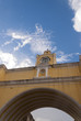 Santa Catalina Arch & ruins in Spanish colonial town & UNESCO World Heritage Site and clouds.