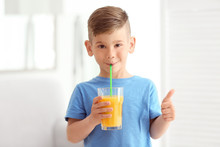 Cute Little Boy Drinking Juice...