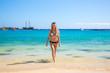 Beautiful girl on the Amadores beach on Gran Canaria island