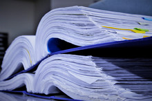 Many Paper Files On The Desk