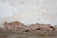 Aged Brick Wall With Cracked Plaster