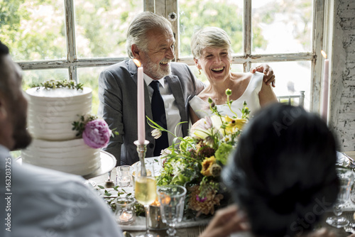 Photo  Senior Caucasian Couple Sitting Together Cheerful