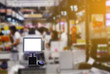 Point of sale retail service computerised terminal in the supermarket of departmentstore or pos terminal at the shop using paying credit card for purchases
