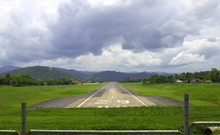 Plane Landing On Runway Of A Small Airfield.