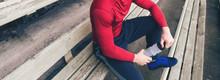 Man Athlete In Sportswear Sitt...