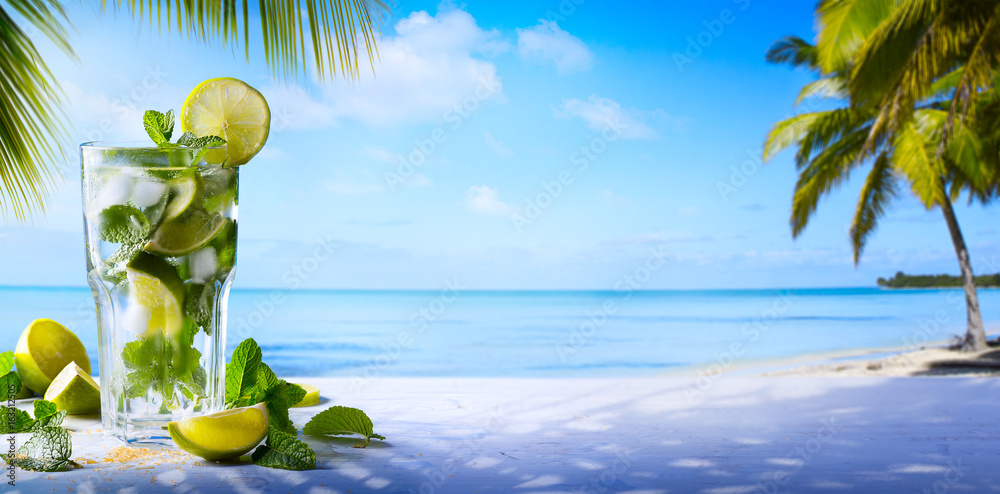 Fototapeta tropic summer vacation; Exotic drinks on blur tropical beach background