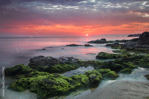 Photographie  Stones at sunset in the sea