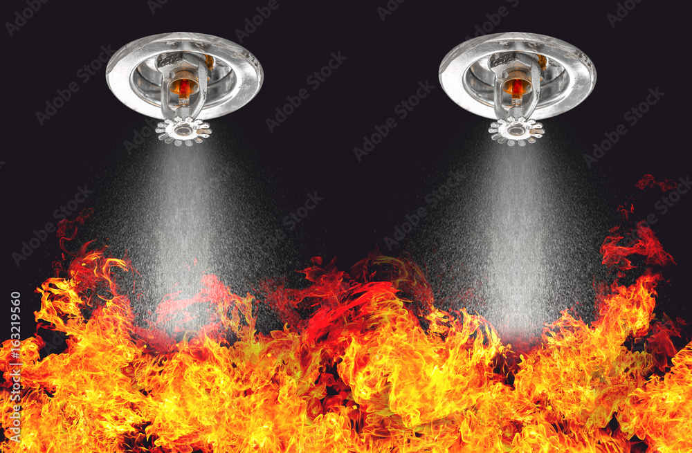 Fototapety, obrazy: Image of Fire Sprinklers Spraying with fire background. Fire sprinklers are part of an overall safety protocol for fire and life safety.