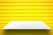canvas print picture - white wooden plank shelves and yellow wooden wall  background. For product display.