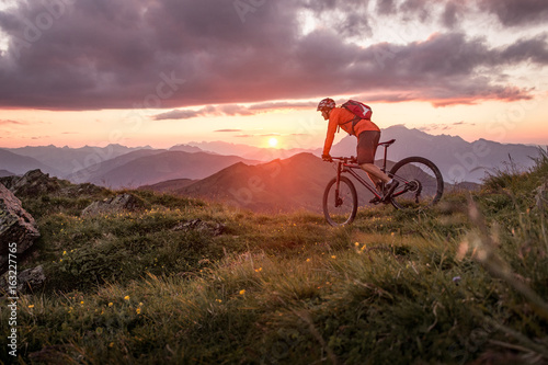 Male mountainbiker at sunset in the mountains Canvas Print